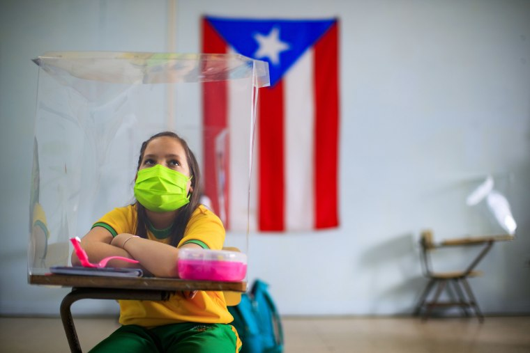 A student wears a mask at a school in Cayey, Puerto Rico, on March 4, 2021.
