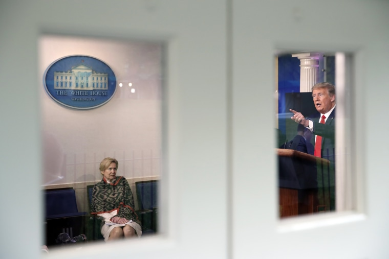 Image: Dr. Deborah Birx listens to President Trump in the White House briefing room.