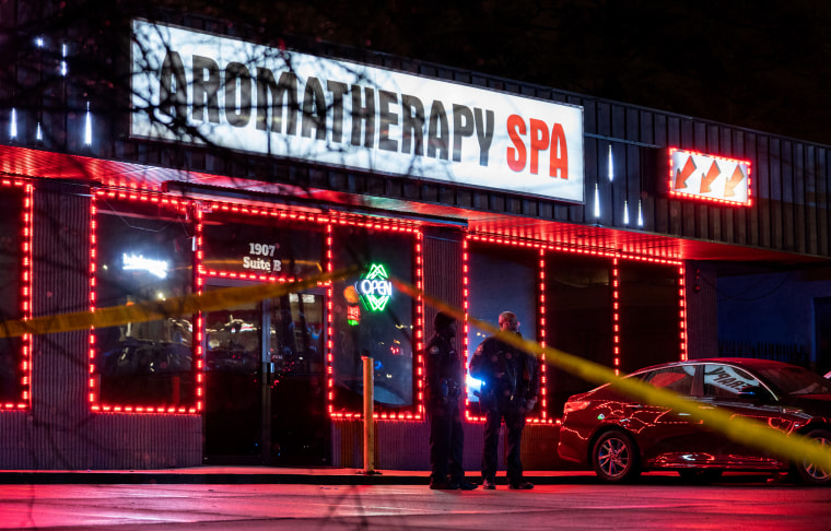 """Image: Police officers outside a message parlor that has a sign that reads,\""""Aromatherapy Spa\"""" in Atlanta, Georgia."""
