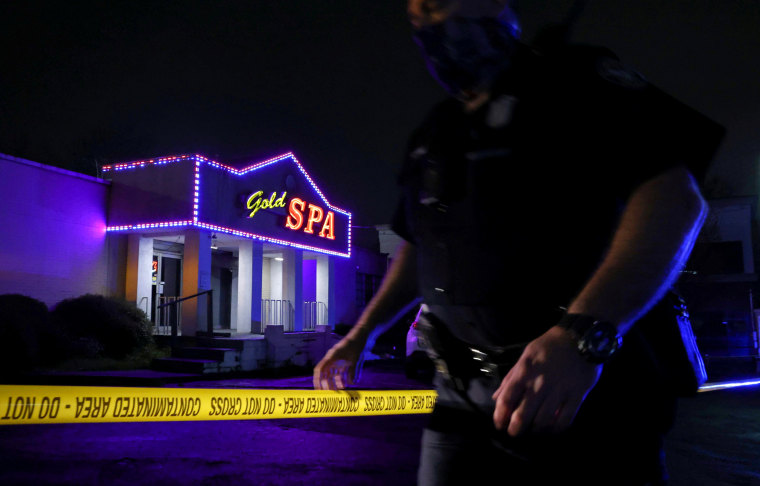 Image: A police officer at the taped scene outside of Gold Spa in Atlanta, Georgia.