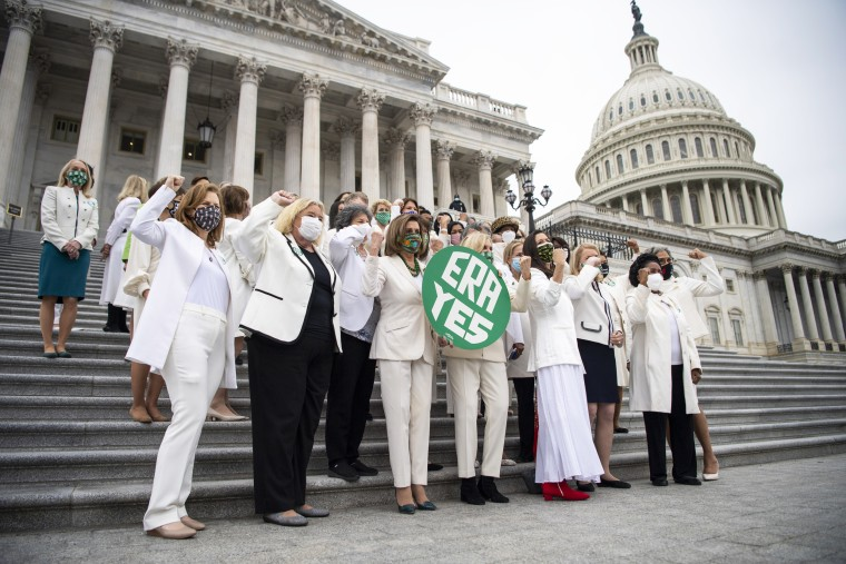 Democratic lawmakers stand on the House steps after passing a joint resolution to remove the Equal Rights Amendment deadline in Washington March 17, 2021.