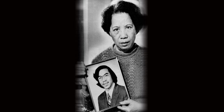 Image: Lily Chin holds a photograph of her son Vincent Chin.