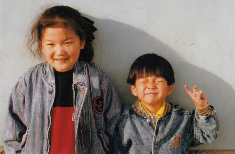 Michelle Yang with her brother just before immigrating to the U.S.