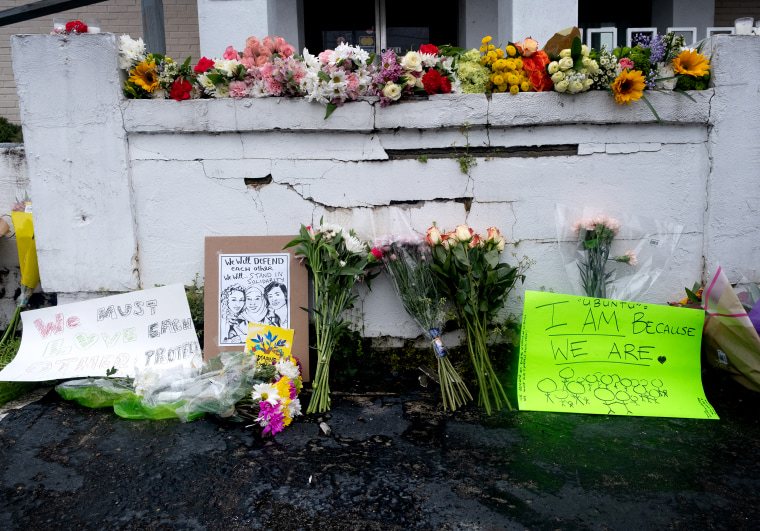 Image: A memorial at Gold Spa in Atlanta, with flowers, signs and candles.