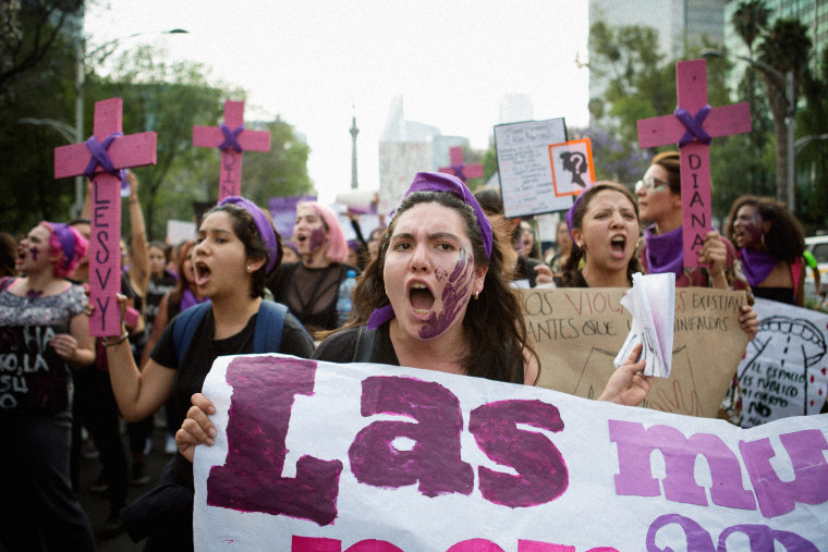 Image: Demonstrators with signs and crosses for the victims of femicide attend a national strike on International Women's Day in Mexico City on March 8, 2018.