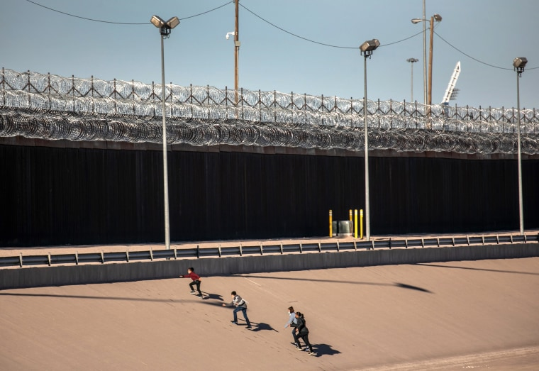 Image: Migrants Cross From Mexico Into U.S. Near Ciudad Juarez