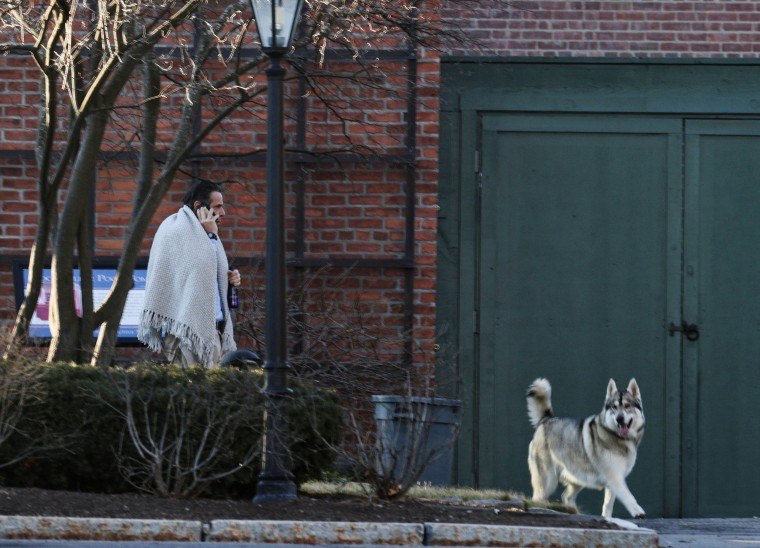 Image: New York Governor Andrew Cuomo walks on the grounds of the Governor's Mansion following allegations that he had sexually harassed young women, in Albany, New York