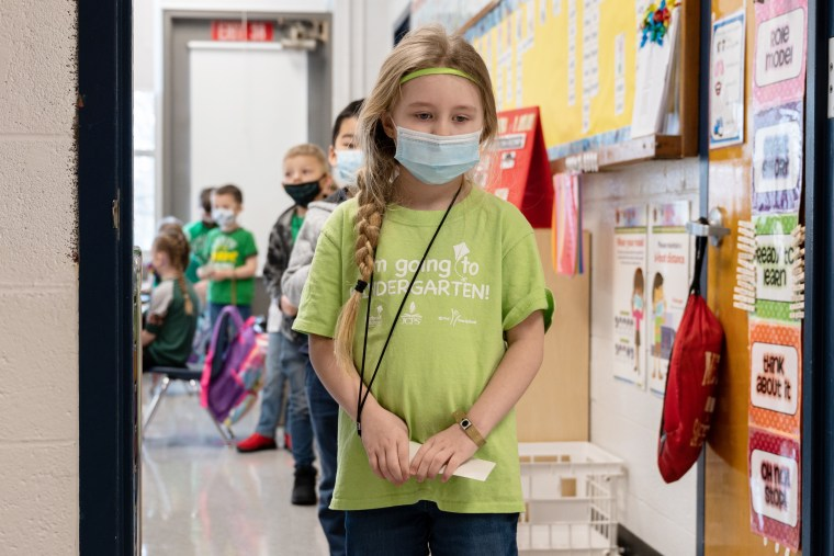 Masked students wait in a socially distanced single file line at Medora Elementary School, Louisvillle, KY.