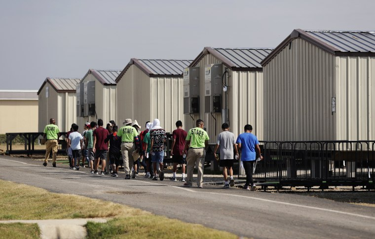 Image: Staff escort immigrants to class at the U.S. government's holding center for migrant children in Carrizo Springs, Texas, on July 9, 2019.