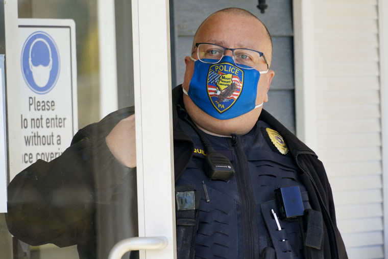 Image: Mount Pleasant Township Police Chief Lou McQuillan answers the door at the municipal building in Hickory, Pa