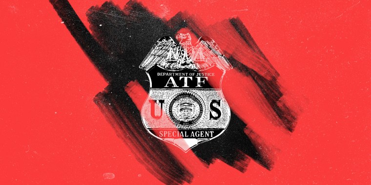 "Photo illustration of a red layer being removed off a badge against a black dusty background . The badge reads,""Department of Justice ATP U.S. Special Agent. A seal on it reads, \""Bureau of Alcohol, Tobacco, Firearms and Explosives, 1972\""."