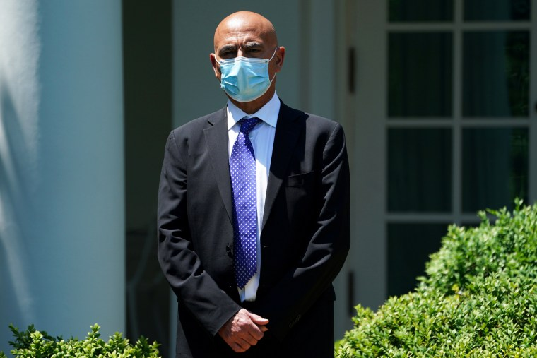 Former GlaxoSmithKline executive Moncef Slaoui waits to speak during a coronavirus disease response event at the White House on May 15, 2020.