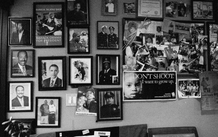 Image: Photographs at the Ebony Barber Shop in the Fifth Ward, a historic Black community, in Evanston, Illinois, on March 17, 2021.