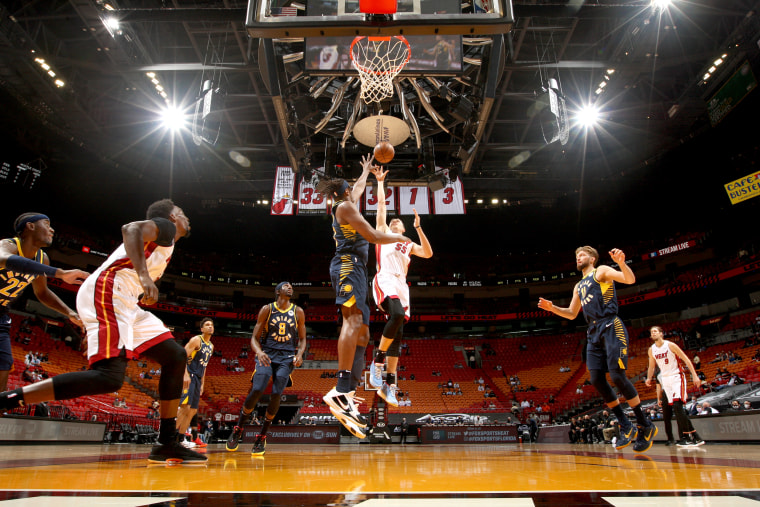 Duncan Robinson #55 of the Miami Heat shoots the ball against the Indiana Pacers on March 21, 2021 at American Airlines Arena in Miami.