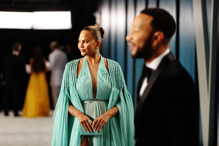 Image: Chrissy Teigen and John Legend attend the 2020 Vanity Fair Oscar Party hosted by Radhika Jones at Wallis Annenberg Center for the Performing Arts on Feb. 9, 2020 in Beverly Hills, Calif.