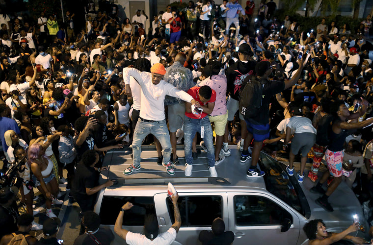 Image: People gather while exiting the area as an 8pm curfew goes into effect on March 21, 2021 in Miami Beach, Fla.