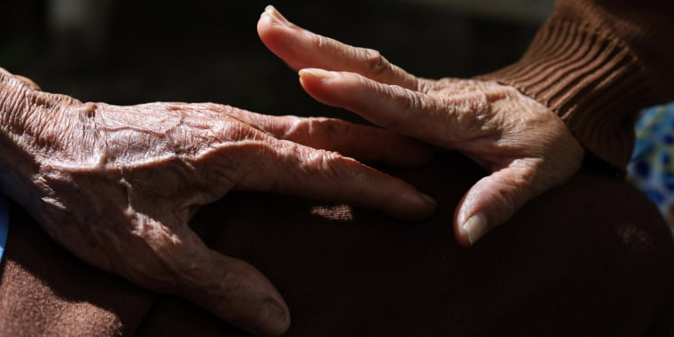 Elderly hand and caregiver