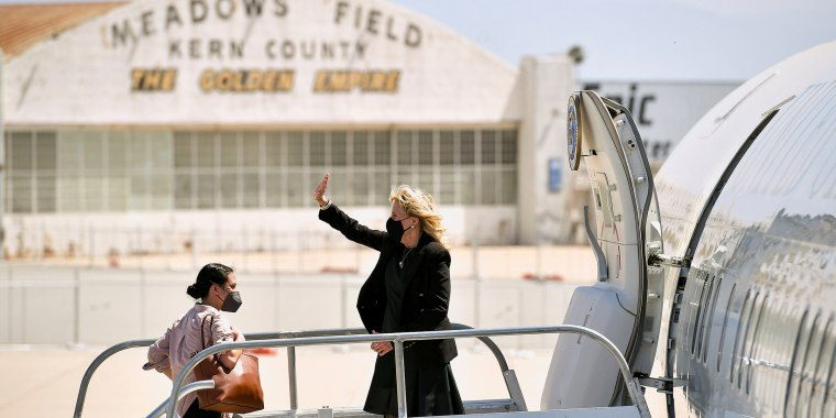 Image: U.S. first lady Jill Biden waves as she boards a plane before departing from Meadows Field Airport in Bakersfield, California