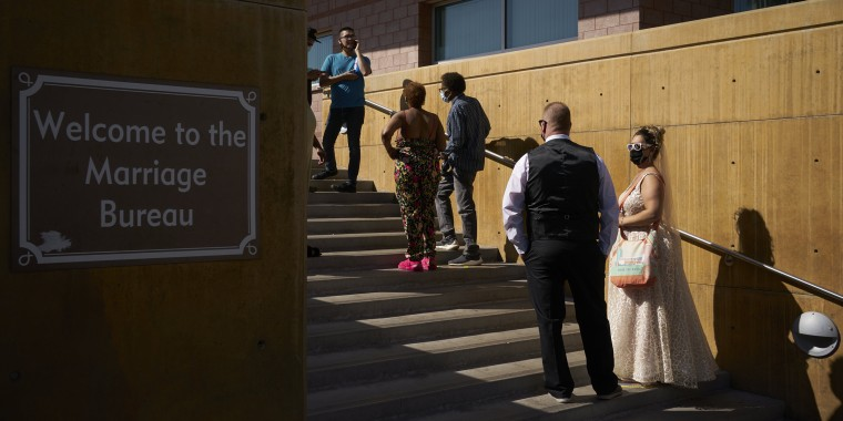 Hundreds of couples waited to secure marriage licenses in Las Vegas Friday.