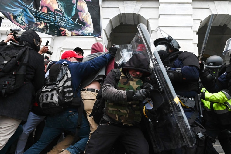 Image: Riot police push back a crowd of supporters of President Donald Trump after they stormed the Capitol building on Jan. 6, 2021