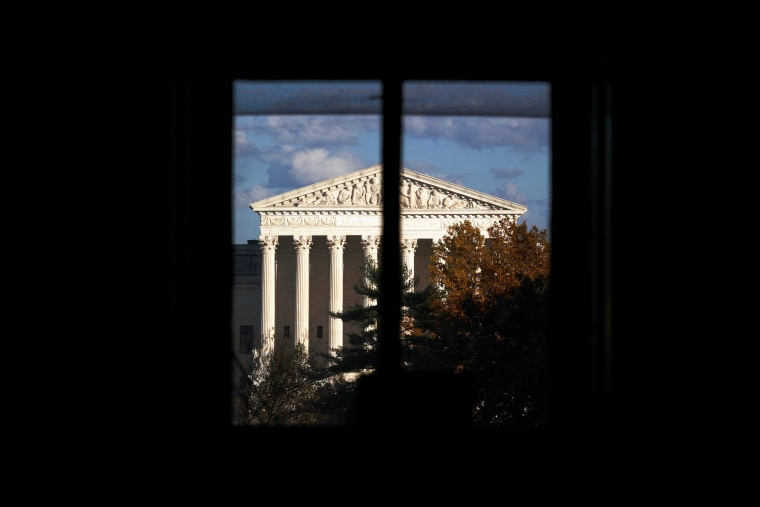 Image: The Supreme Court building is seen through a window in Washington on Nov. 10, 2020.