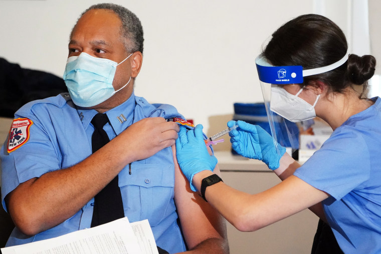 A worker for the New York City Fire Department Bureau of Emergency Medical Services receives Moderna's Covid-19 vaccination on Dec. 23, 2020.