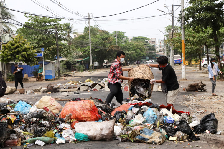 """Anti- coup protesters throw garbage on a street after activists launched a \""""garbage strike\"""" against the military rule in Yangon, Myanmar March 30, 2021"""