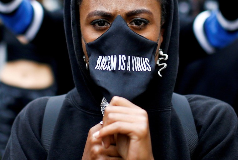 Image: A demonstrator wears a protective mask during a Black Lives Matter protest near Piccadilly Circus in London,