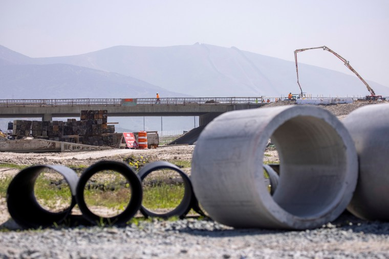 Image: Work crews continue to work on the construction of a freeway overpass in San Diego