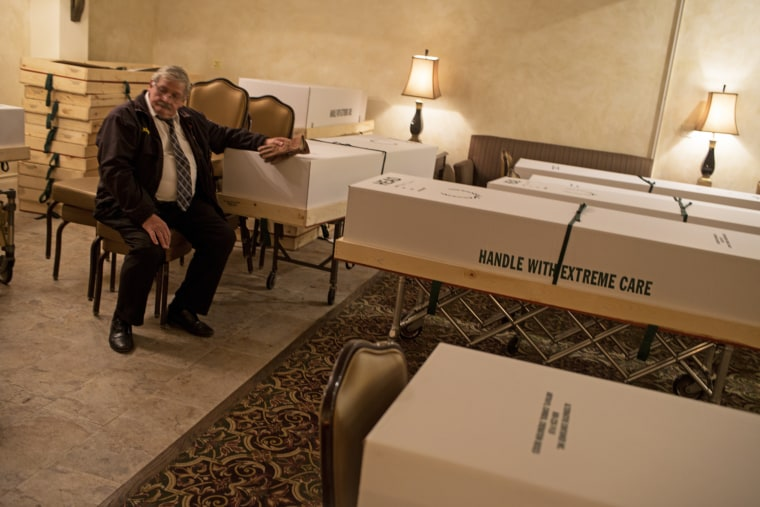 Ray Neufeld, a retired funeral home director who came back to work to deal with the excessive numbers of Covid-19 deaths, takes a break from loading bodies onto a moving truck on May 11, 2020, in Queens, N.Y.