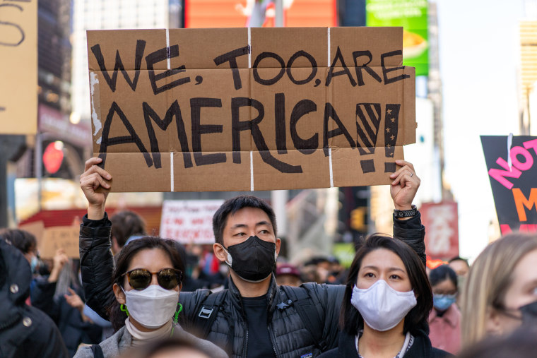 People gather for a march to express solidarity for Asian American and Pacific Islander communities on March 20, 2021, in New York following the mass shooting in Atlanta.