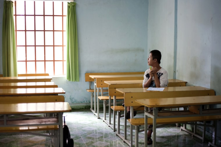Image: Chu Thanh Nhan, 12, in an empty classroom at a rehabilitation center in Danang, Vietnam, in 2012.