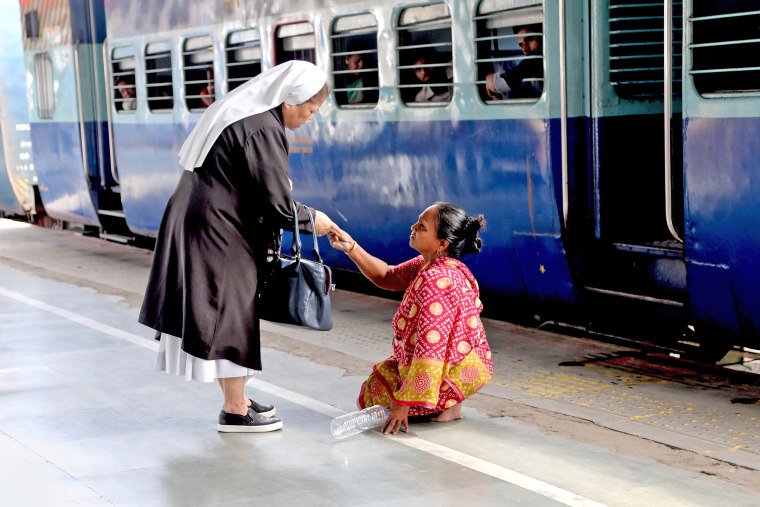 Sister Rose Paite consoles a woman in the Guwahati Railway Station in Assam, India.