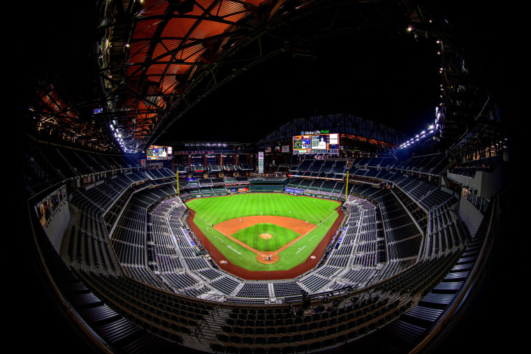 Image: The stands and the open roof during the game between the Texas Rangers and the Houston Astros at Globe Life Field.