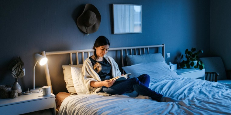 Woman reading in her bed at night. What is Book of the Month? The Book of the Month club is a monthly book subscription box offering one hardcover book a month at a flat price to subscribers.