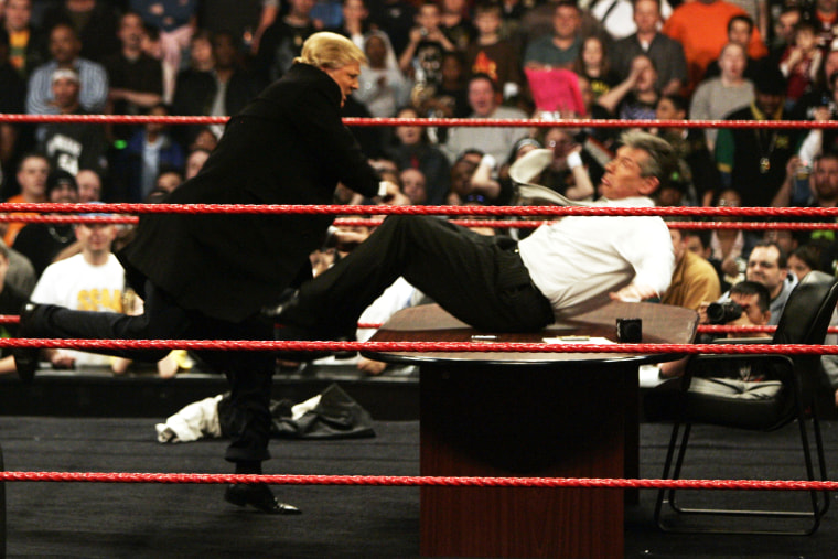 """Vince McMahon gets more than he bargained for when Donald Trump got physical after signing the contract for Wrestlemania XXIII's \""""Hair vs Hair\"""" match at Monday Night RAW in Washington on March 12, 2007."""