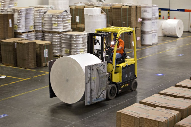 Image: An employee operates a fork lift to move a roll of paper pulp during production at the Kimberly-Clark Corp. Neenah Cold Spring facility in Neenah, Wisc.