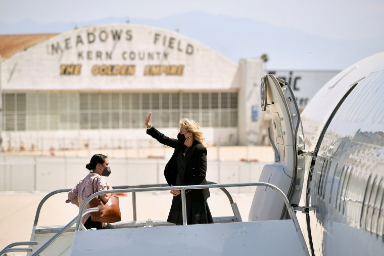 Image: First lady Jill Biden waves as she boards a plane before departing from Meadows Field Airport in Bakersfield, California