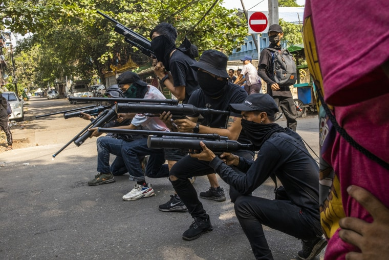 Anti-coup protesters line in formation with homemade air rifles during a demonstration against the military coup in Yangon, Myanmar, Saturday, April 3, 2021.