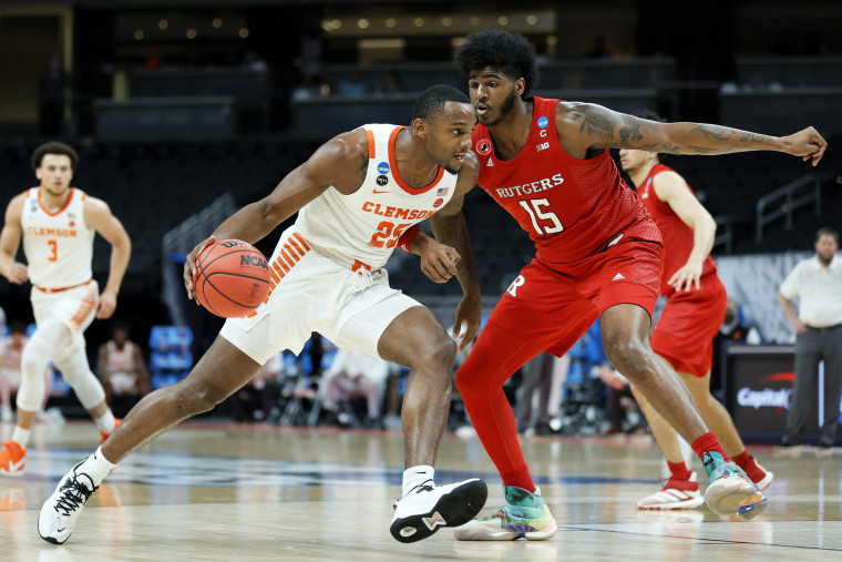 Aamir Simms #25 of the Clemson Tigers handles the ball in the first half against Myles Johnson #15 of the Rutgers Scarlet Knights on March 19, 2021, in Indianapolis.