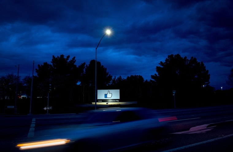 A car passes by Facebook's corporate headquarters in Menlo Park, Calif., on March 21, 2018.