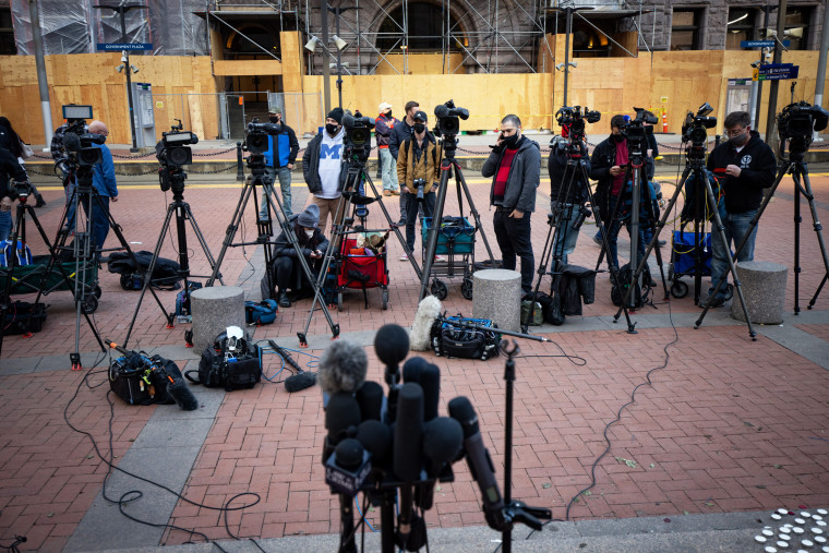 Members of the media wait for the start of a news conference outside the Hennepin County Government Center in Minneapolis on March 8, 2021.