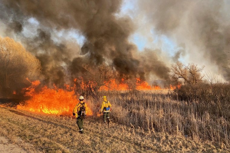 Wisconsin DNR fire crews fight a wildfire in Menomonee Falls that burned nearly 450 acres of marshland on Friday, and has since been contained.