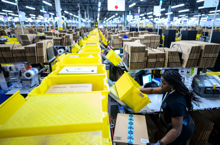 A woman works at a packing station at the 855,000-square-foot Amazon fulfillment center in Staten Island, N.Y., on Feb. 5, 2019.