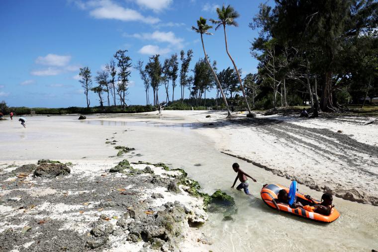 Image: Children play on Eton Beach in Efate, Vanuatu, in 2019.