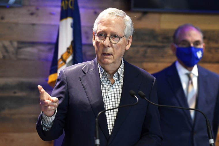Senate Minority Leader Mitch McConnell, R-Ky., listens to a reporter's question at a Covid-19 vaccination site in Lexington, Ky., on April 5, 2021.
