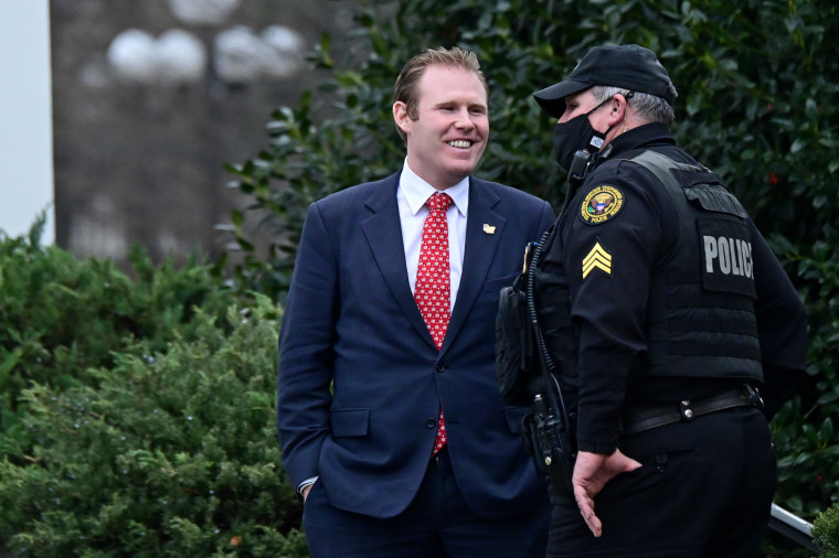 Andrew Giulian speaks to a Secret Service officer outside the West Wing of the White House in Washington