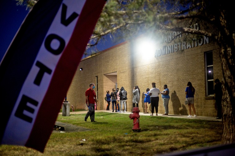With an hour left to vote, people wait in line at Manor ISD Administration building on Nov. 3, 2020 in Austin, Texas.