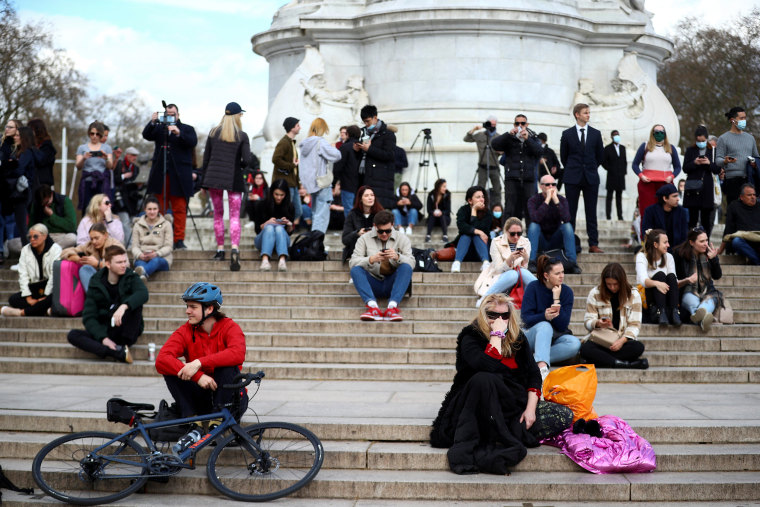Image: Mourners gather outside Buckingham Palace after Prince Philip has died in London