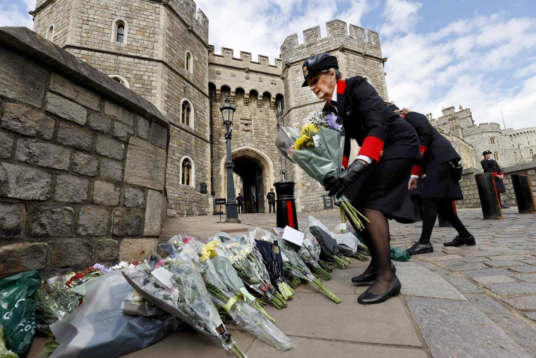 Image: Wardens of the Castle move floral tributes to the side of the driveway at the Henry VIII Gate of Windsor Castle, in Windsor, west of London